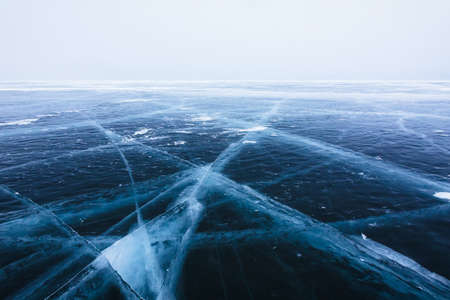 Beautiful ice with cracks on the Lake Baikal. Stock Photo