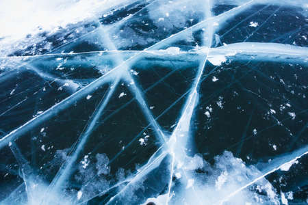 Beautiful pure ice with cracks on the Lake Baikal.