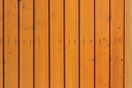 Brown wooden facade  wooden wall  wood cladding  wood paneling Banco de Imagens