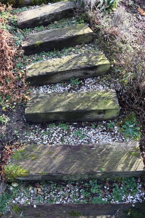 Railway sleepers made of wood as stairs in the garden