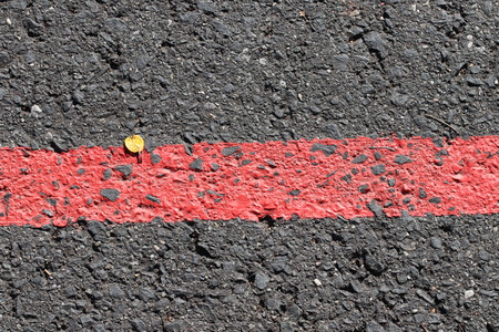Red line  red dash on the ground  asphalt