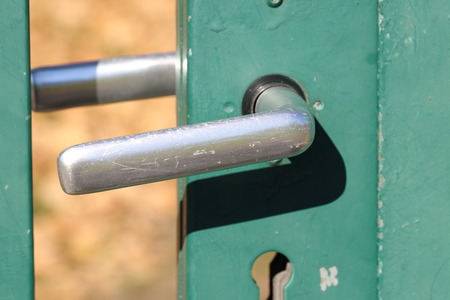 Exceptionnel Scratched Door Latch Of A Green Garden Gate Stock Photo   97809549
