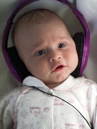 babyface: baby with lilac headphones close-up