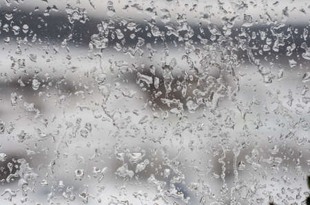frosted window: drops frost glass background blurred winter