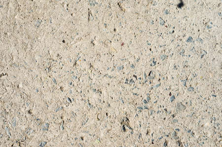 interspersed: Concrete surface close-up of interspersed stones background