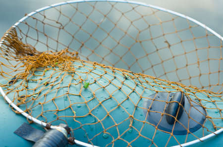A fishing net lies on the background of an inflatable boat Stock Photo