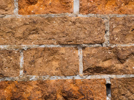 old textured weathered brickwork with embossed concrete mortar. Background