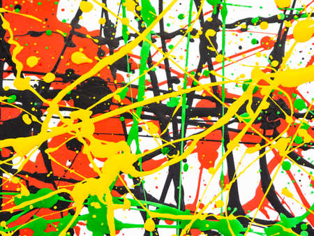 splashed of spilled yellow green red black paint. expressionism