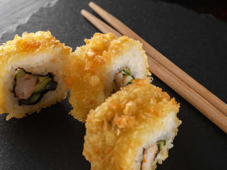 homemade rolls in tempura. Japanese food. close up 스톡 콘텐츠