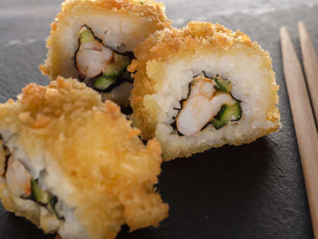 homemade rolls in tempura. Japanese food. close up Imagens
