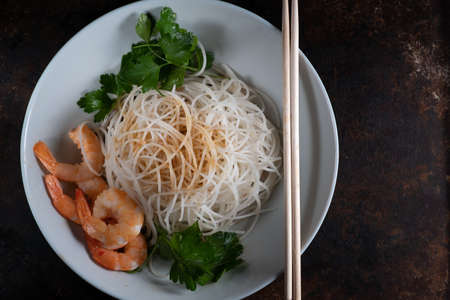Shrimp and delicious rice noodles with vegetables. top view flatlay. Horizontal