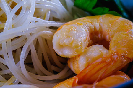 Shrimp and delicious rice noodles with vegetables. macro. Horizontal