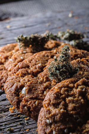 biscuits with hemp on an old wooden background close-up. rustic. Horizontal orientation.