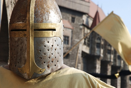 Medieval knight helmet armor in front of a Gothic castle Stock Photo - 17759697