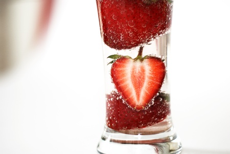 carbonated: Strawberry immersed in the glass of a carbonated beverage