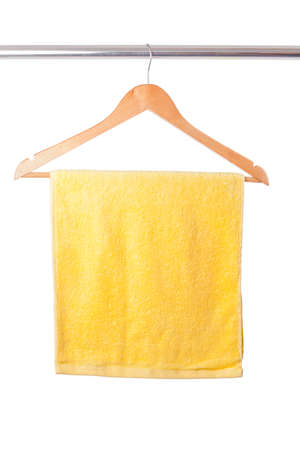 Yellow towel on hanger isolated on white background photo