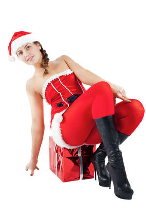 smiling woman in red xmas sexy costume with gift photo
