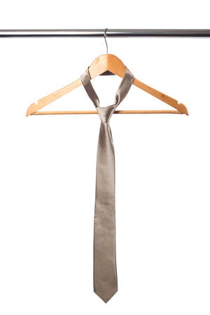 tie and coat hanger isolated on white photo