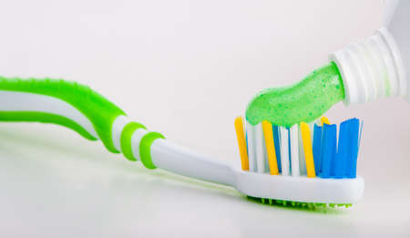 Tooth brush with tooth paste on white background. photo