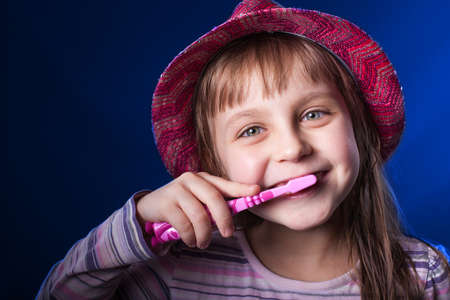 Pretty Kid Brushing Teeth photo