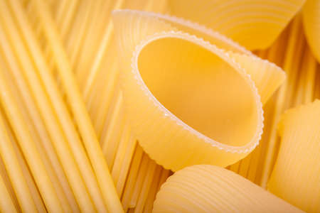 Close up shoot of different types of raw pasta. photo