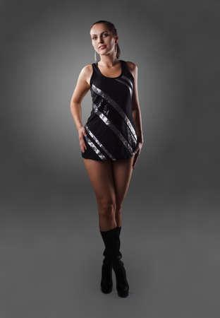Beautiful elegant young woman wearing black dress Stock Photo