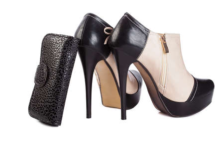 high heels boots and purse on white background