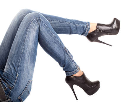 The lying girl a close up of legs in the jeans, isolated photo