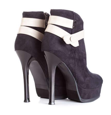 Beautiful high heels platform pump shoe in italian luxury black leather. Stock Photo - 12853728