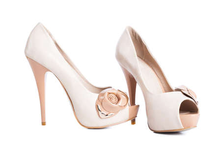 biege: Biege high heel shoes isolated on white