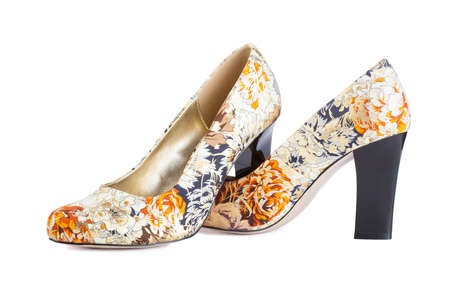 Flowers print shoes isolated on white Imagens