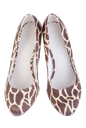 giraffe print high shoes on a white background photo