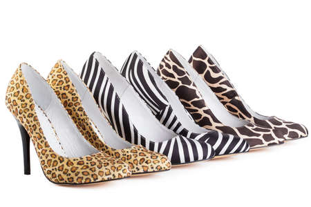 Row of three  various women shoes in shop; new collection, isolated