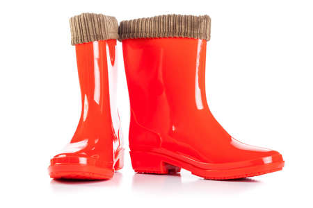 Red Rain Boots isolated on white photo