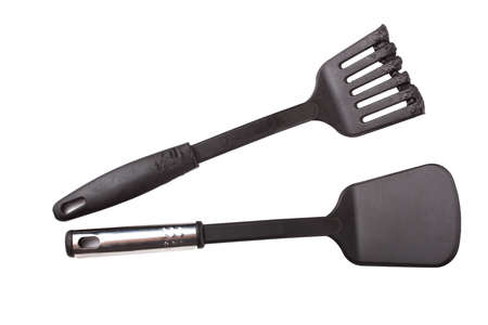 New and damaged plastic kitchen utensil. Isolated on white background