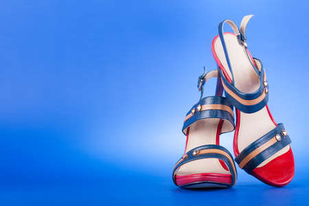 High heel shoes on blue background photo