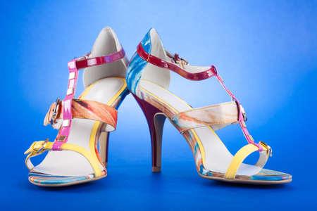 stylish woman's opened shoe on blue background Stock Photo - 13929306