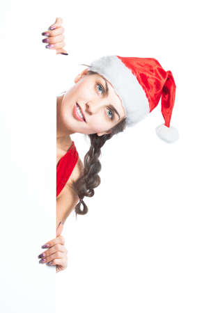 young and beautiful Christmas girl holding empty board - isolated photo