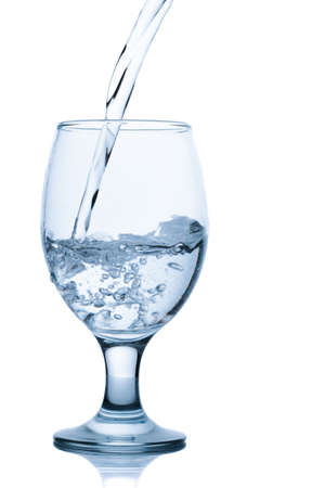 Pouring water into glass isolated on white background Stock Photo - 15440590