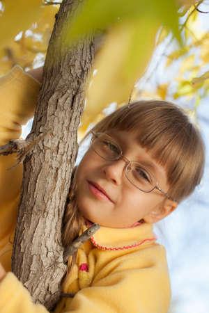 climbed: small child climbed on tree