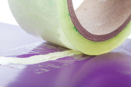 sellotape: Two pieces of paper join by adhesive tape Stock Photo