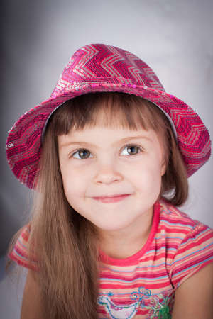 Portrait of an adorable baby girl in pink hat   photo