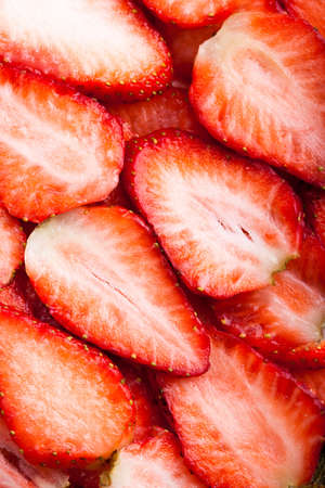 pices: Sliced strawberris as background Stock Photo
