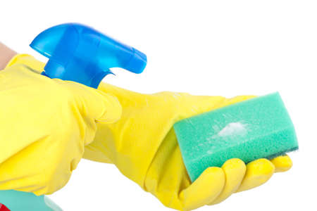 disinfecting: Hands wearing rubber gloves holding a sponge and cleaning spray bottle isolated on white Stock Photo