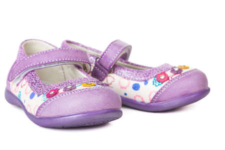 photo of object s: Shoes for little girls isolated on white background Stock Photo