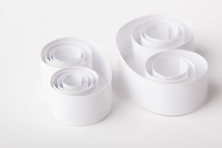 furl: Paper Roll on Background Stock Photo