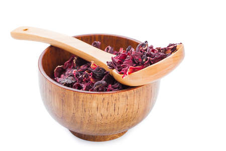 Bowl of aromatic Hibiscus tea with wooden spoon, isolated on white photo