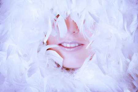 Beautiful woman with white feathers photo