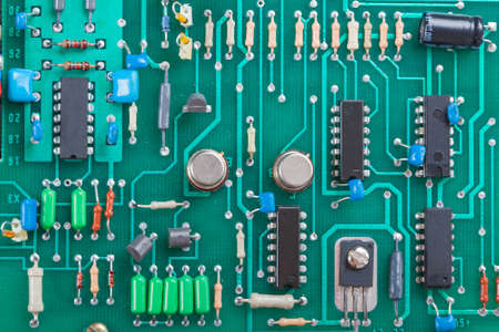 conductor electricity: Detail of an electronic printed circuit board with many electrical components Stock Photo