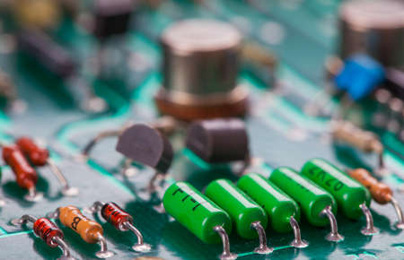 ic: Detail of an electronic printed circuit board with many electrical components Stock Photo